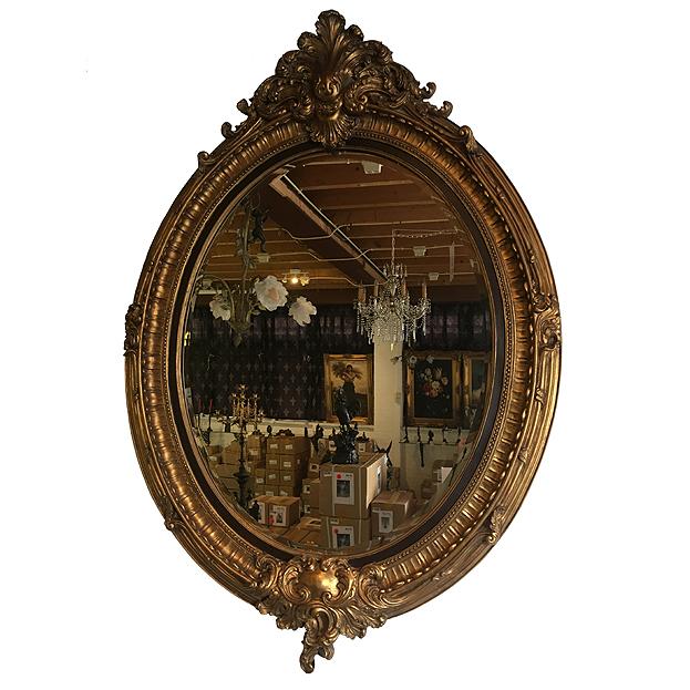 ovale spiegel met gouden lijst